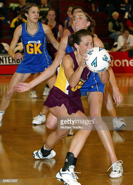 Southlands Tania Dalton recieves the ball under pressure from Otagos Anna Scarlett during the match between Southland and Otago in the Smokefree...