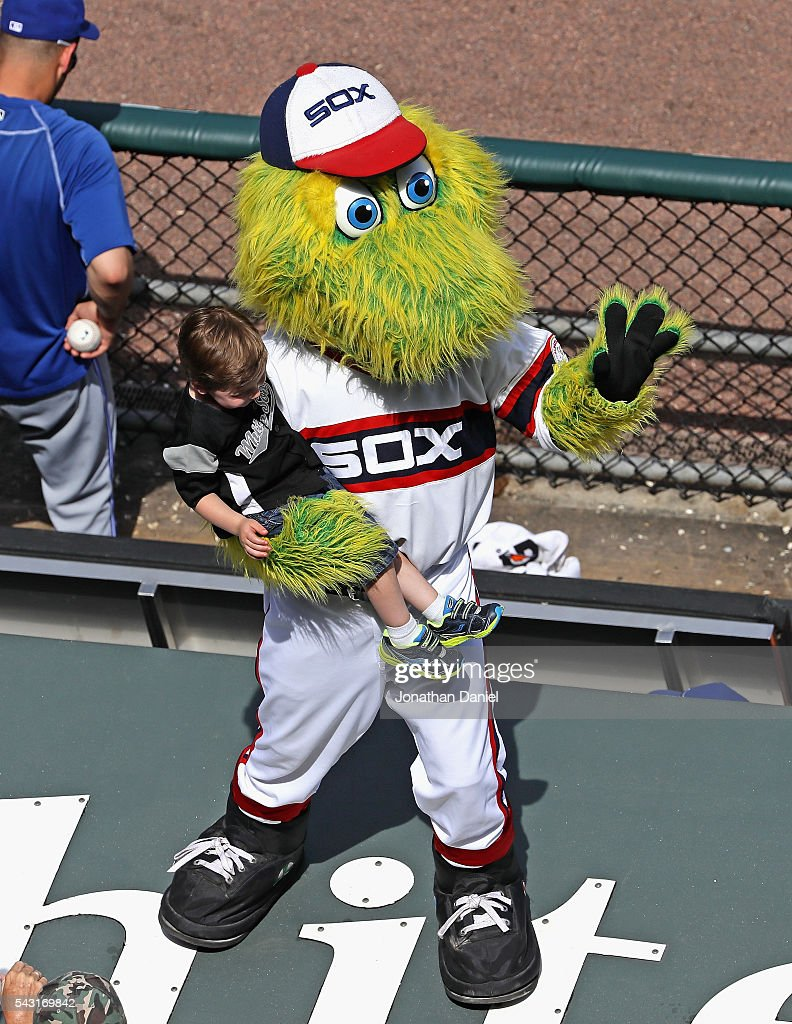 'Southpaw,' the mascot for the Chicago White Sox, holds a child during the 7th inning stretch of a game betwen the White Sox and the Toronto Blue Jays at U.S. Cellular Field on June 26, 2016 in Chicago, Illinois. The White Sox defeated the Blue Jays 5-2.