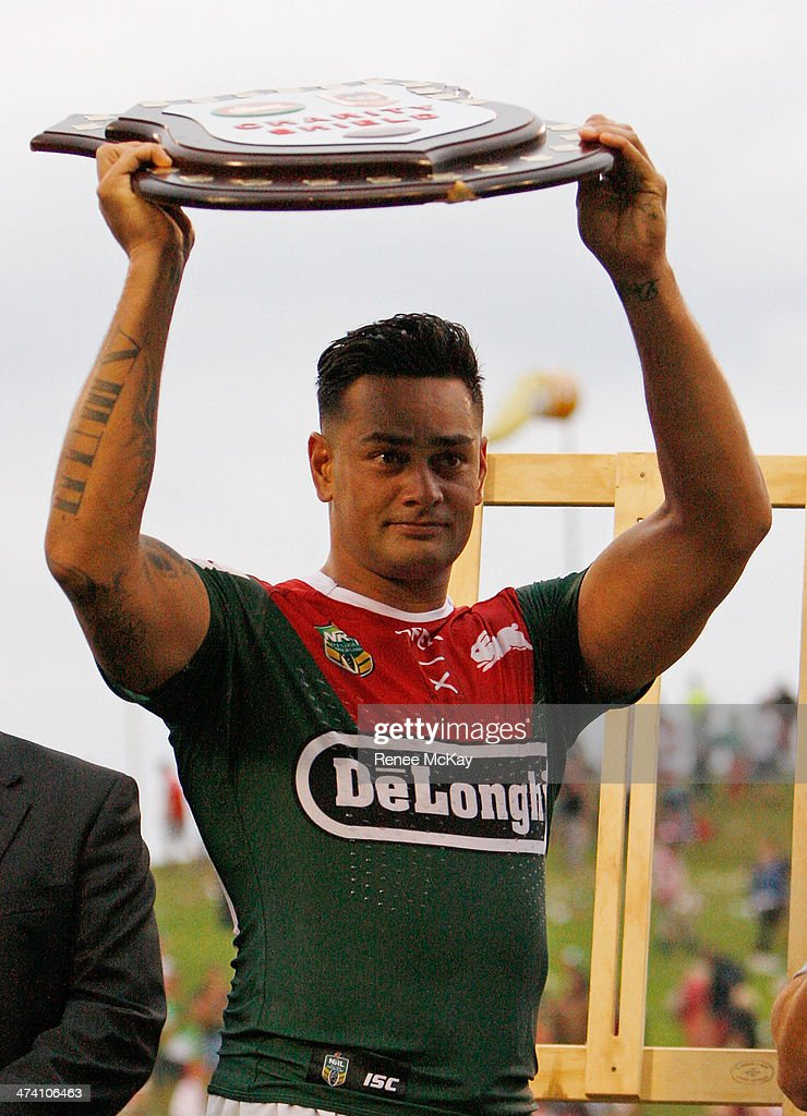 Souths captain John Sutton holds the Charity Shield after the NRL Charity Shield match between the South Sydney Rabbitohs and the St George Dragons at WIN Stadium on February 22, 2014 in Wollongong, Australia.