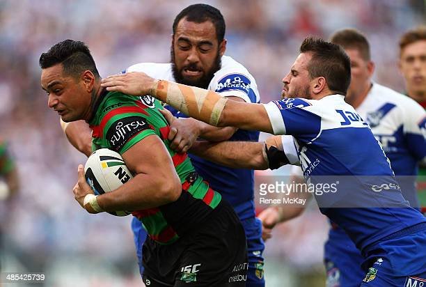 Souths captain John Sutton is tackled by Sam Kasiano and Josh Reynolds during the round seven NRL match between the South Sydney Rabbitohs and the...