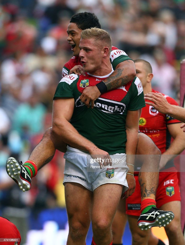 Souths try scorer George Burgess celebrates his try with team mate Issac Luke during the NRL Charity Shield match between the South Sydney Rabbitohs and the St George Dragons at WIN Stadium on February 22, 2014 in Wollongong, Australia.