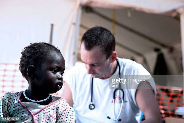 A SouthSudanese girl waits for treatment at the Medecins Sans Frontieres hospital in Juba on February 22 2014 The World Health Organisation has...
