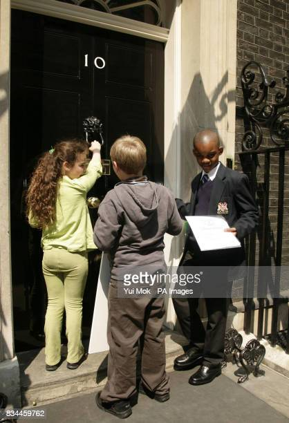 Southwark school children with dyslexia Cara Abraham Cameron Simson and Lenny Zvinoria outside 10 Downing Street central London to deliver an 'end of...