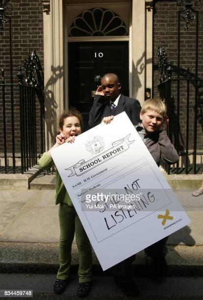 Southwark schoolchildren with dyslexia Cara Abraham Lenny Zvinoria and Cameron Simson outside 10 Downing Street central London before delivering an...