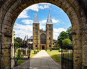 Southwell Mister and Romanesque Cathedral in Nottinghamshire, England, UK, viewed through the arcade of the main entry gate