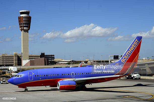 Southwest Airlines Boeing 737 passenger aircraft sits on the tarmac at Phoenix Sky Harbor International Airport in Phoenix Arizona The airport's...