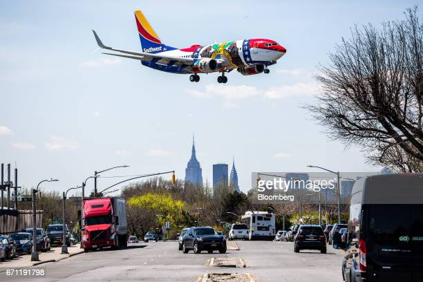 A Southwest Airlines Co plane prepares for landing at LaGuardia Airport in New York US on Tuesday April 18 2017 An additional section of land could...