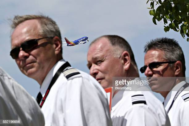 A Southwest Airlines Co plane takes off as representatives and pilots from the Southwest Airlines Pilots' Association demonstrate outside Chicago...