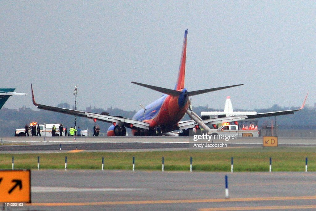 A Southwest Airlines flight remains on runway 4 after the plane's landing gear collapsed shortly after touching down on the runway, at LaGuardia Airport in the Queens borough of New York City. The flight, which originated in Nashville, landed at 5:45 p.m. and was carrying 149 passengers and crew. A reported 10 people were injured.