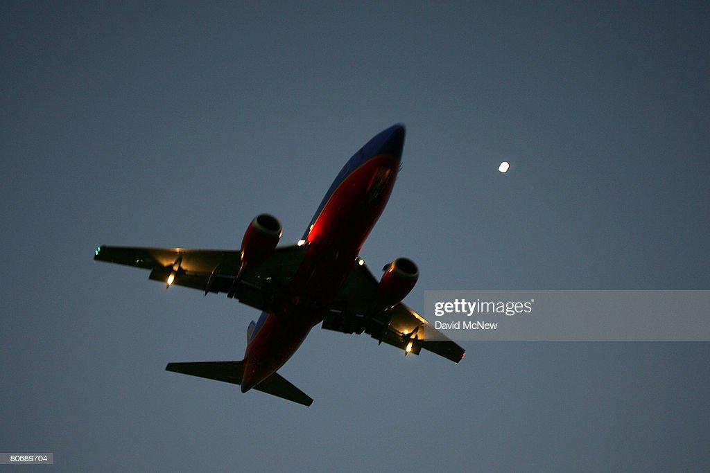 A Southwest airlines jet comes in for landing at Los Angeles International Airport (LAX) on April 15, 2008 in Los Angeles, California. With skyrocketing fuel prices and a weak economy, US airlines are turning to mergers which could ultimately lead to higher fares through reduced flights and increased market power. US carriers emerged from a five-year slump in 2006 but with $35 billion in losses. In the latest merger move to save profits, Delta Air Lines Inc will buy Northwest Airlines Corp for more than $3 billion, creating the world's biggest airline. Recent profit challenges to the industry have lead to the shutdown of ATA, Skybus, and Aloha Airlines as well as bankruptcy for Frontier Airlines.