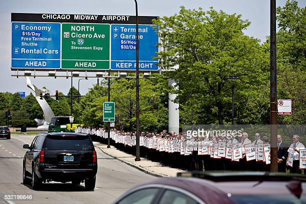 Southwest Airlines Pilots' Association representatives and pilots demonstrate along a road outside Chicago Midway International Airport in Chicago...