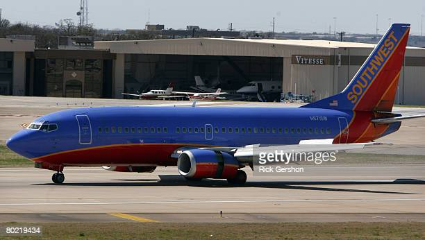 Southwest Airlines plane taxis on the runway at airline's hub at Dallas Love Field March 12 in Dallas Texas Southwest Airlines said it has grounded...