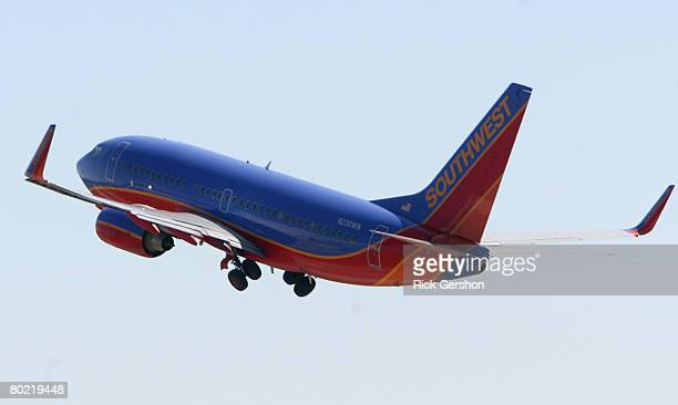 Southwest Airlines planes take off from the airline's hub at Dallas Love Field Airport March 12 in Dallas Texas Southwest Airlines said it has...