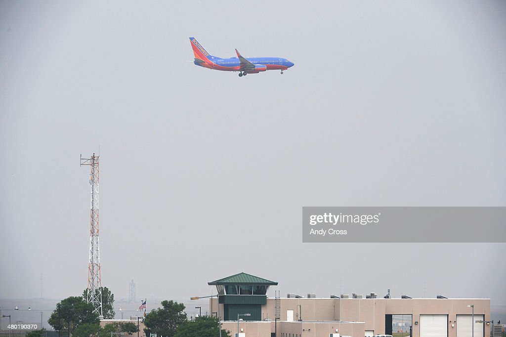 Southwest airplane cuts through the haze for a landing at Denver International Airport July 08 2015