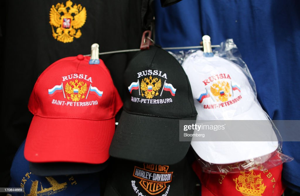 Souvenir baseball caps sit for sale at a tourist stall ahead of the St. Petersburg International Economic Forum 2013 (SPIEF) in St. Petersburg, Russia, on Wednesday, June 19, 2013. The Russian Deputy Prime Minister Igor Shuvalov told the conference that the country's World Trade Organization accession negotiations could be further delayed unless several remaining disputed matters are solved. Photographer: Andrey Rudakov/Bloomberg via Getty Images