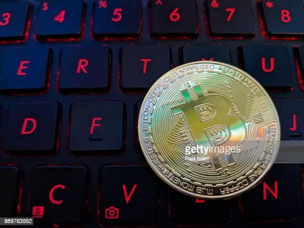 Souvenir bit coin on keyboard.