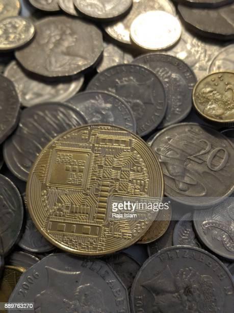 Souvenir bitcoin with coin stack.