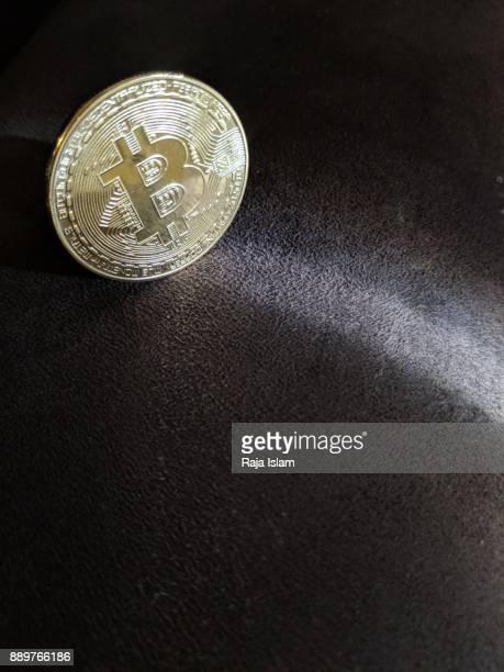 Souvenir bitcoin with light ray