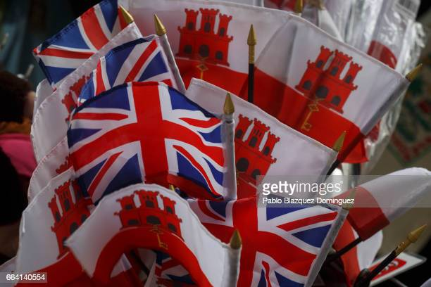 Souvenir flags of United Kingdom and Gibraltar are on display in a shop on April 3 2017 in Gibraltar Tensions have risen over Brexit negotiations for...