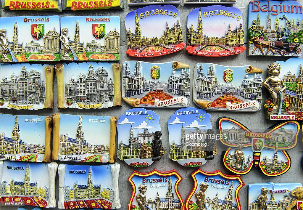 Souvenir fridge magnets bearing Brussels city landmarks and coat-of-arms are seen for sale outside a tourist store on the Grand Place in Brussels, Belgium, on Monday, May 13, 2013. Euro-area data this week will probably reveal economic scars of the sovereign debt crisis confirming that the region is now suffering the longest recession since the single currency's creation. Photographer: Jock Fistick/Bloomberg via Getty Images