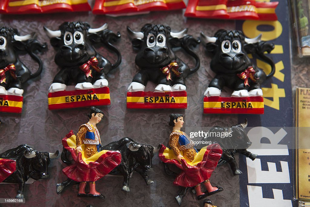 Souvenir fridge magnets featuring Spanish bulls and matadors stand for sale at a tourist store in Madrid, Spain, on Friday, June 8, 2012. Spain is poised to become the fourth of the 17 euro-area countries to require emergency assistance as the currency bloc's finance chiefs plan weekend talks on a potential aid request to shore up the nation's lenders. Photographer: Angel Navarrete/Bloomberg via Getty Images