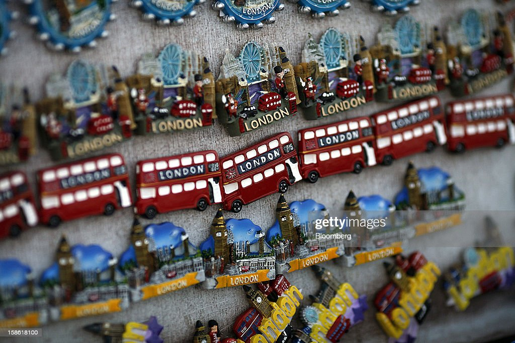 Souvenir fridge magnets of double decker buses and city sites sit on display in a tourist store in London, U.K., on Friday, Dec. 21, 2012. Britain's economy expanded less than previously estimated in the third quarter and the budget deficit unexpectedly widened in November, complicating Prime Minister David Cameron's attempts to bolster the recovery. Photographer: Simon Dawson/Bloomberg via Getty Images