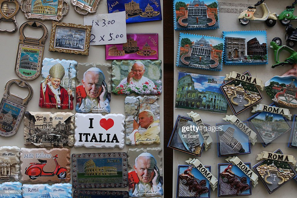 Souvenir magnets, some depicting Pope John Paull II, are displayed for sale on February 25, 2013 in Rome, Italy. The Pontiff will hold his last weekly public audience on February 27, 2013 before he retires the following day. Pope Benedict XVI has been the leader of the Catholic Church for eight years and is the first Pope to retire since 1415. He cites ailing health as his reason for retirement and will spend the rest of his life in solitude away from public engagements.