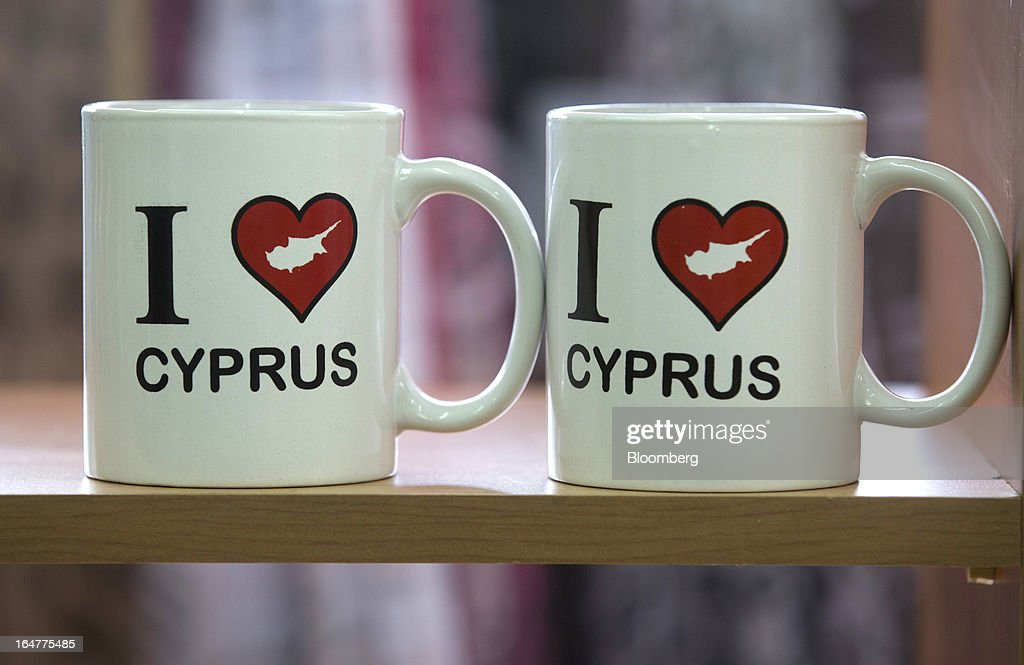 Souvenir mugs decorated with 'I love Cyprus' designs stand for sale in a tourist store in Limassol, Cyprus, on Wednesday, March 27, 2013. The ECB said on March 25 it won't stop the Cypriot central bank from providing the island's banking sector with emergency funding. Photographer: Simon Dawson/Bloomberg via Getty Images