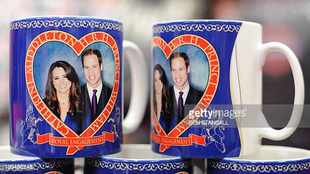 Souvenir mugs for the royal wedding of Britain's Prince William and Kate Middleton are pictured in a shop in central London on January 18 2011 Prince...
