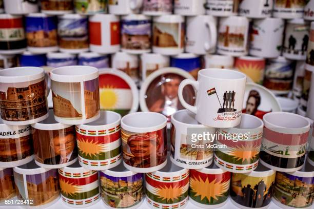 Souvenir mugs showing the face of Kurdish President Masoud Barzani are seen for sale at a shop in the old city on September 22 2017 in Erbil Iraq The...