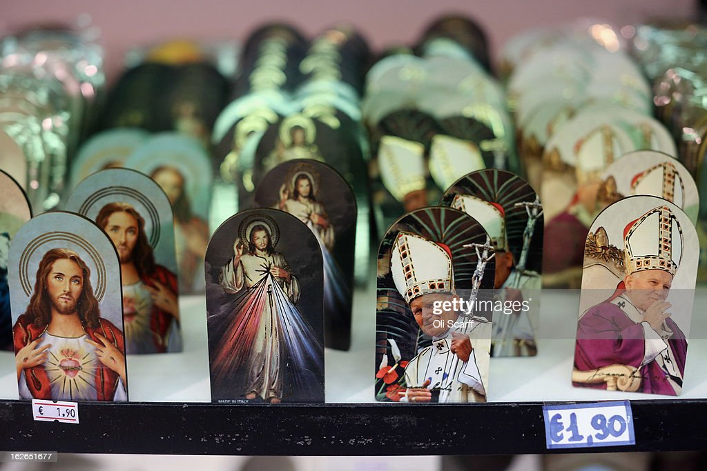 Souvenir photographs bearing the image of Jesus Christ and Pope John Paul II are displayed for sale on February 25, 2013 in Rome, Italy. The Pontiff will hold his last weekly public audience on February 27, 2013 before he retires the following day. Pope Benedict XVI has been the leader of the Catholic Church for eight years and is the first Pope to retire since 1415. He cites ailing health as his reason for retirement and will spend the rest of his life in solitude away from public engagements.