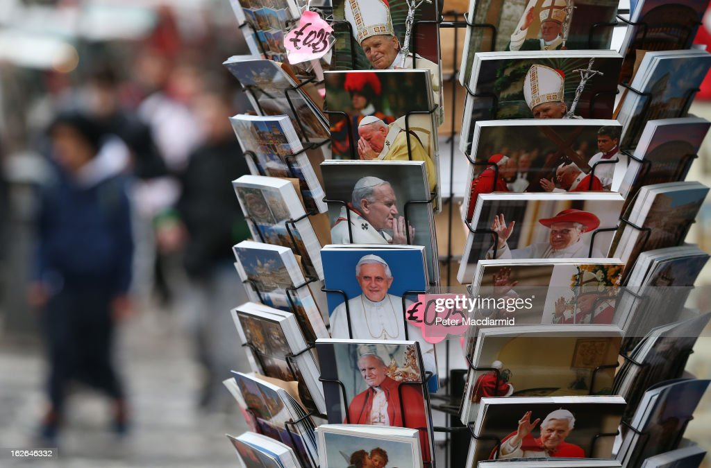 Souvenir postcards depicting Pope Benedict XVI and Pope John Paul II are sold on February 25, 2013 in Rome, Italy. The Pontiff will hold his last weekly public audience on February 27, 2013 before he retires the following day. Pope Benedict XVI has been the leader of the Catholic Church for eight years and is the first Pope to retire since 1415. He cites ailing health as his reason for retirement and will spend the rest of his life in solitude away from public engagements