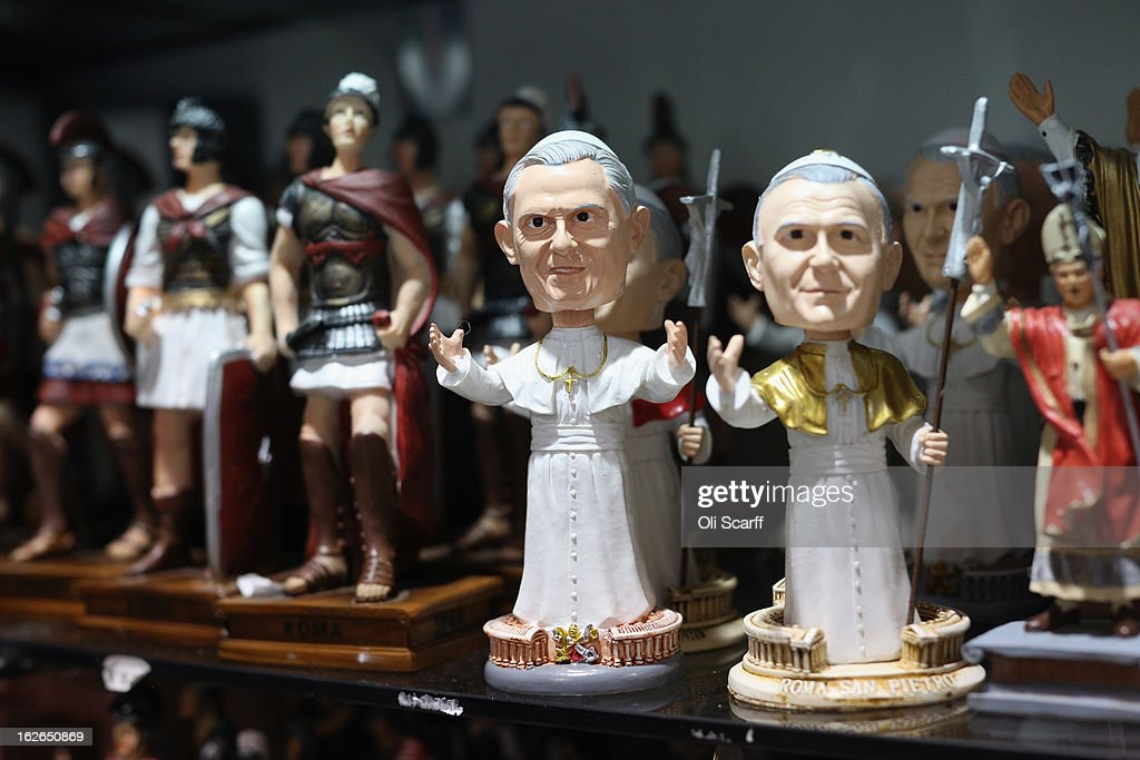 Souvenir religious statues, some depicting the Pope, are displayed for sale on February 25, 2013 in Rome, Italy. The Pontiff will hold his last weekly public audience on February 27, 2013 before he retires the following day. Pope Benedict XVI has been the leader of the Catholic Church for eight years and is the first Pope to retire since 1415. He cites ailing health as his reason for retirement and will spend the rest of his life in solitude away from public engagements.