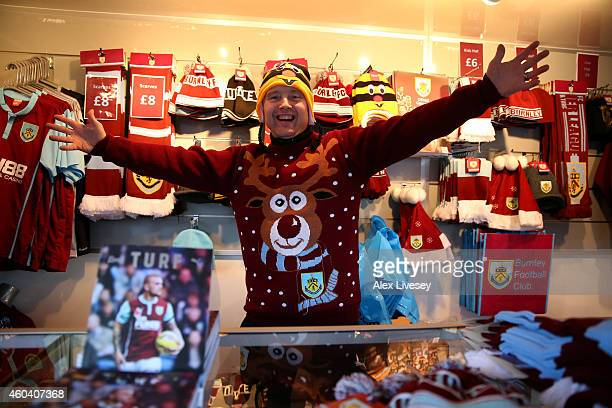 A souvenir seller shows off his christmas jumper prior to the Barclays Premier League match between Burnley and Southampton at Turf Moor on December...