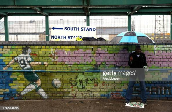 A souvenir seller stands outside Windsor Park prior to the FIFA 2014 World Cup Group F Qualifier match between Northern Ireland and Russia at Windsor...