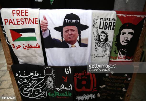 A souvenir shop displays a Tshirt bearing an image of US President Donald Trump dressed as a Hasidic Jew in Jerusalem's Old City on May 18 2017 / AFP...