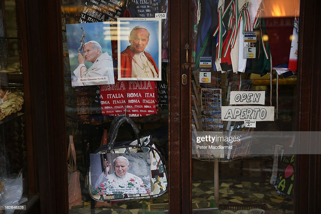 A souvenir shop displays photographs of Pope John Paul II on February 25, 2013 in Rome, Italy. The Pontiff will hold his last weekly public audience on February 27, 2013 before he retires the following day. Pope Benedict XVI has been the leader of the Catholic Church for eight years and is the first Pope to retire since 1415. He cites ailing health as his reason for retirement and will spend the rest of his life in solitude away from public engagements