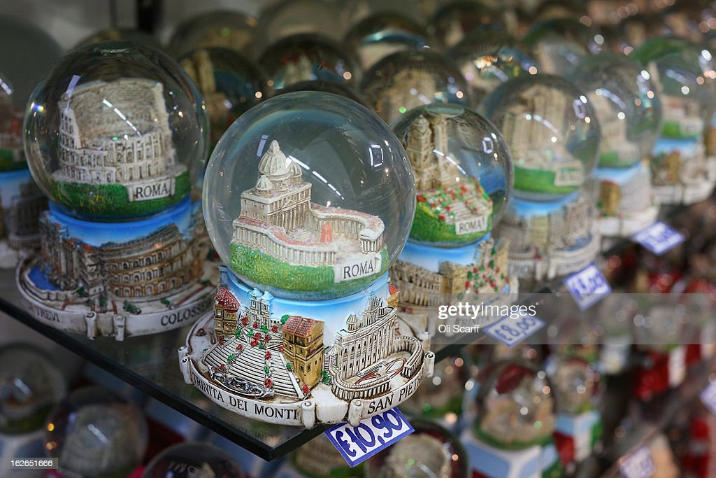 Souvenir snow globes featuring a model of the Vatican's Saint Peter's Square are displayed for sale on February 25, 2013 in Rome, Italy. The Pontiff will hold his last weekly public audience on February 27, 2013 before he retires the following day. Pope Benedict XVI has been the leader of the Catholic Church for eight years and is the first Pope to retire since 1415. He cites ailing health as his reason for retirement and will spend the rest of his life in solitude away from public engagements.