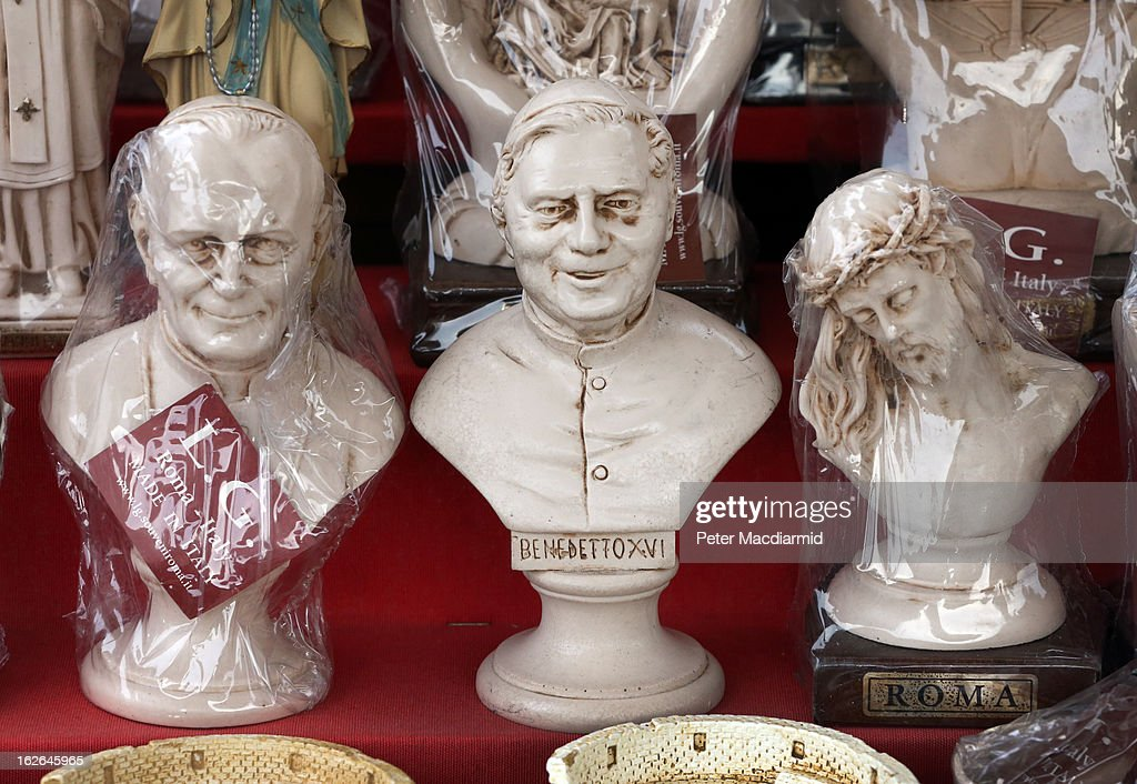 Souvenir statues of Pope John Paul II (L), Pope Benedict XVI and Jesus are displayed for sale on February 25, 2013 in Rome, Italy. The Pontiff will hold his last weekly public audience on February 27, 2013 before he retires the following day. Pope Benedict XVI has been the leader of the Catholic Church for eight years and is the first Pope to retire since 1415. He cites ailing health as his reason for retirement and will spend the rest of his life in solitude away from public engagements.