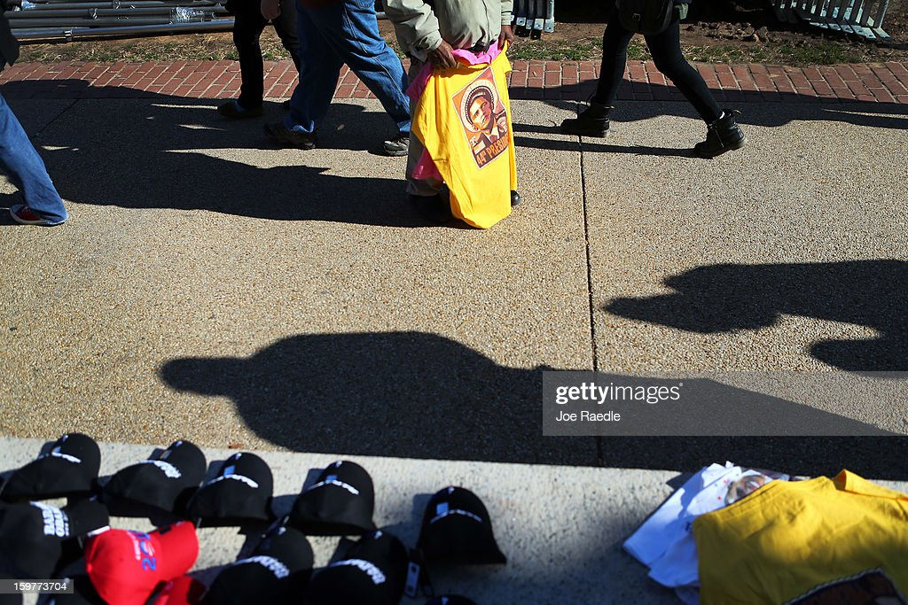 A souvenir vendor holds a tee-shirt as preparations continue for the Presidential Inauguration on January 20, 2013 in Washington, DC. The U.S. capital is preparing for the second inauguration of U.S. President Barack Obama, which will take place on January 21.