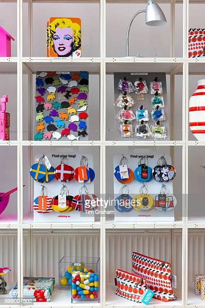 Souvenirs and gifts including Marilyn Monroe by Andy Warhol in shop Arken Museum of Modern Art on June 24 2015 near Copenhagen Denmark