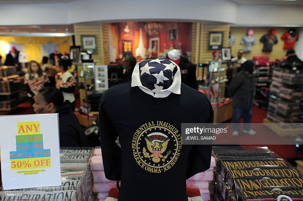 Souvenirs are displayed at a gift shop in Washington, DC, on January 18, 2013. Crowds may be smaller on January 21 inauguration than when Barack Obama was first sworn into office in 2009, but security is as tight as ever, with experts warning a 'lone wolf' would pose the greatest threat. Between 500,000 and 800,000 people are expected to pass through the National Mall, the immense greenway that leads up to the Capitol, compared to the 1.8 million spectators who came to applaud Obama four years ago. AFP PHOTO/Jewel Samad