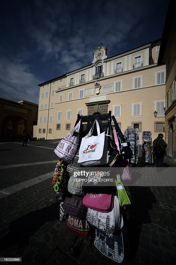 Souvenirs are displayed on February 20, 2013 by the Apostolic Palace on the main square of Castel Gandolfo, Italy. Pope Benedict XVI will stay at the Vatican's summer residence from February 28 until the convent of Mater Ecclesiae (Mother of the Church) at the Vatican will be ready to host him. Pope Benedict XVI began a week-long spiritual retreat out of the public eye on February 18 ahead of his resignation on February 28 with the field of candidates to succeed him still wide open.