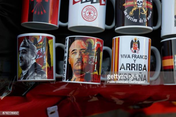 Souvenirs are for sell with the image of Franco and Francoist symbology during a rally commemorating the 42nd anniversary of Spain's former dictator...