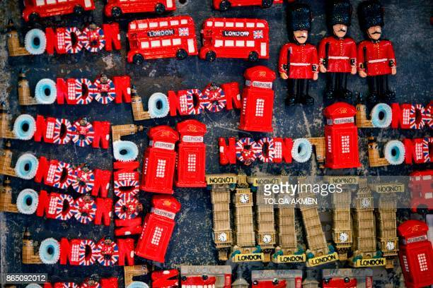 Souvenirs are pictured on display in Covent Garden in London on October 22 2017 Britain could be left 'poorer and weaker' by Brexit and needing to...