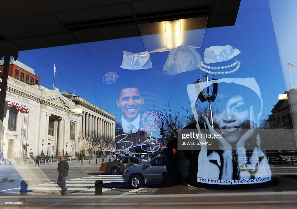 Souvenirs featuring pictures of US President Barack Obama and First Lady Michelle Obama are displayed at a gift shop in Washington, DC, on January 18, 2013. Crowds may be smaller on January 21 inauguration than when Barack Obama was first sworn into office in 2009, but security is as tight as ever, with experts warning a 'lone wolf' would pose the greatest threat. Between 500,000 and 800,000 people are expected to pass through the National Mall, the immense greenway that leads up to the Capitol, compared to the 1.8 million spectators who came to applaud Obama four years ago. AFP PHOTO/Jewel Samad