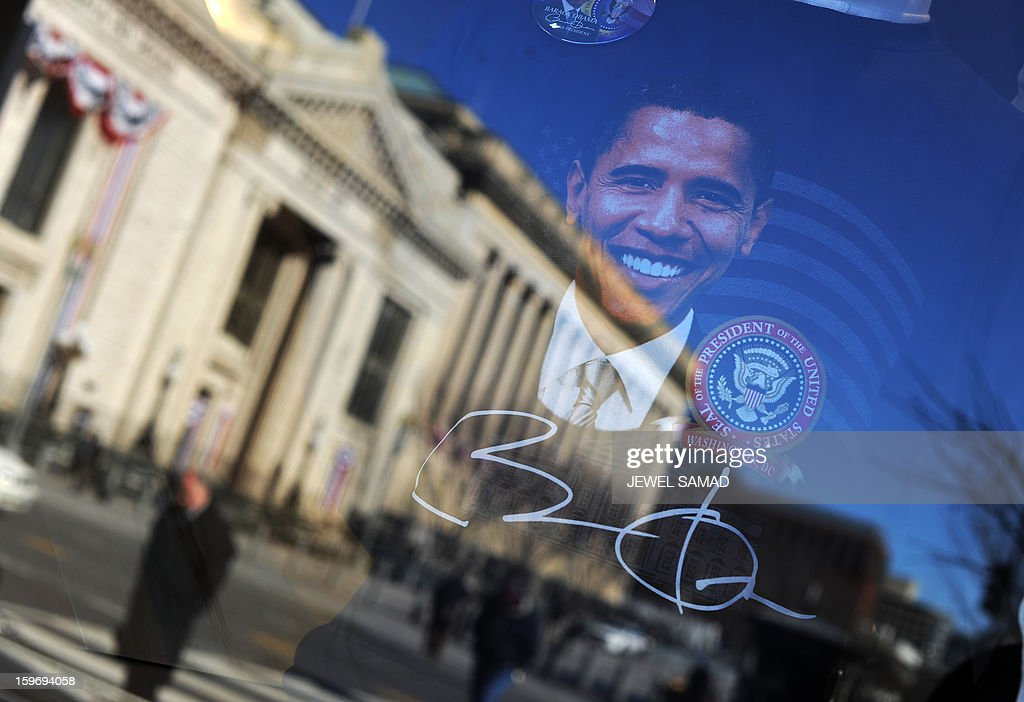 Souvenirs featuring pictures of US President Barack Obama are displayed at a gift shop in Washington, DC, on January 18, 2013. Crowds may be smaller on January 21 inauguration than when Barack Obama was first sworn into office in 2009, but security is as tight as ever, with experts warning a 'lone wolf' would pose the greatest threat. Between 500,000 and 800,000 people are expected to pass through the National Mall, the immense greenway that leads up to the Capitol, compared to the 1.8 million spectators who came to applaud Obama four years ago. AFP PHOTO/Jewel Samad