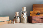 souvenirs like a bottles with seashells, books and wooden boxes from different countries