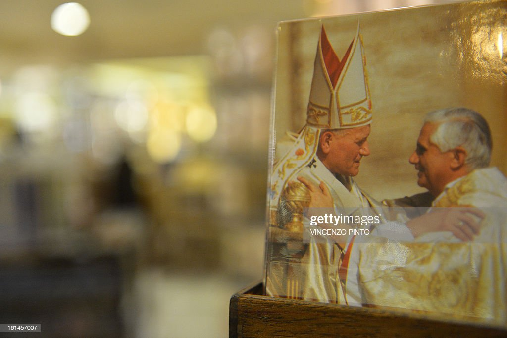 Souvenirs showing Pope Benedict XVI (R) and Pope John Paul II are displayed in a shop near the Vatican after it was announced that Pope Benedict XVI will resign on February 11, 2013. Pope Benedict XVI on February 11, 2013 announced he will resign on February 28, a Vatican spokesman told AFP, which will make him the first pope to do so in centuries.