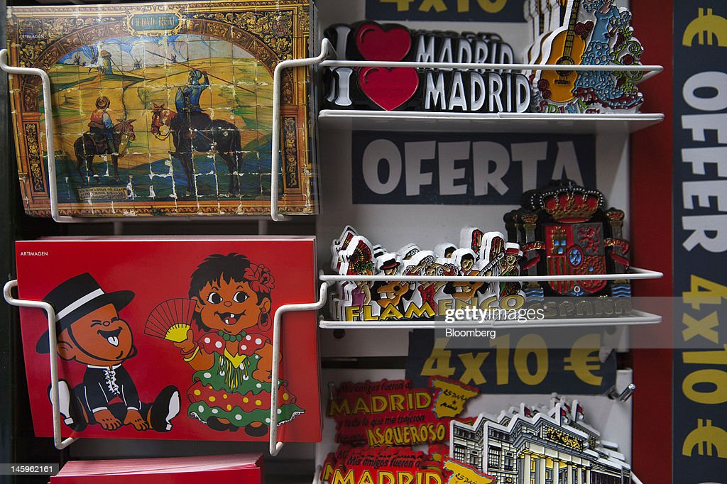 Souvenirs sit on display at a tourist store in Madrid, Spain, on Friday, June 8, 2012. Spain is poised to become the fourth of the 17 euro-area countries to require emergency assistance as the currency bloc's finance chiefs plan weekend talks on a potential aid request to shore up the nation's lenders. Photographer: Angel Navarrete/Bloomberg via Getty Images